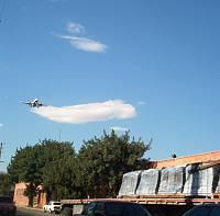 Truck of tilemolds and airplane landing